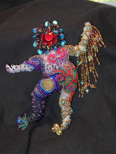 Heavily beaded art doll -