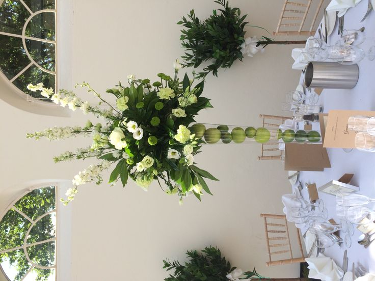 Beautiful table designs at The Orangery at Wrest Park in white and lime green using apples and limes - www.wildorchidweddingflowers.co.uk