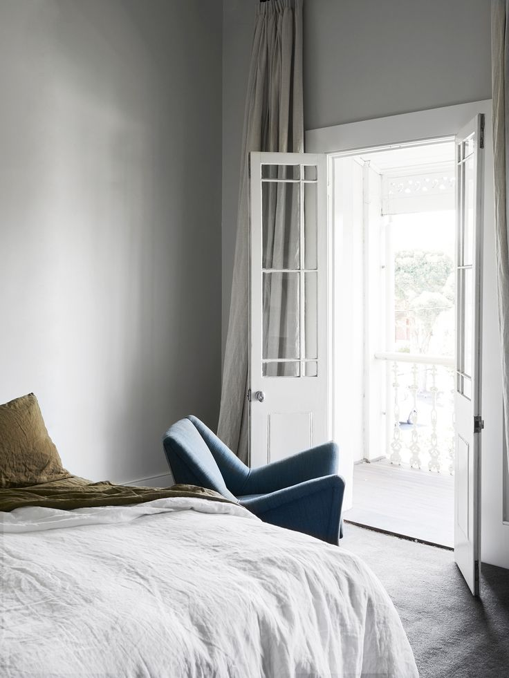 Creating a comfortable bedroom is sometimes as simple as adding linen bedding. This bedroom in a renovated Melbourne terrace allows the French doors to be the main feature in the room. Photography: Brooke Holm   Styling: Marsha Golemac   Story: Belle