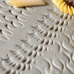 Clay imprinted with pasta - Great Texture idea for clay construction projects.