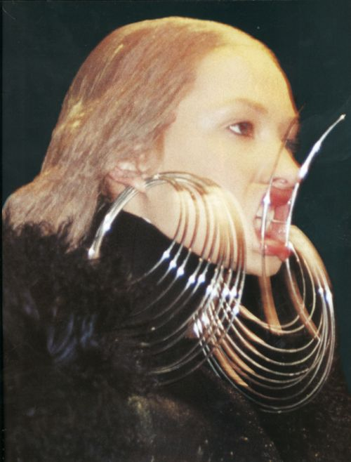 Another mysogynist instrument of torture on the fashion runway, this time by bad boy of fashion Alexander McQueen. A/W 2000.   Photographed by Juergen Teller for Nova Magazine.