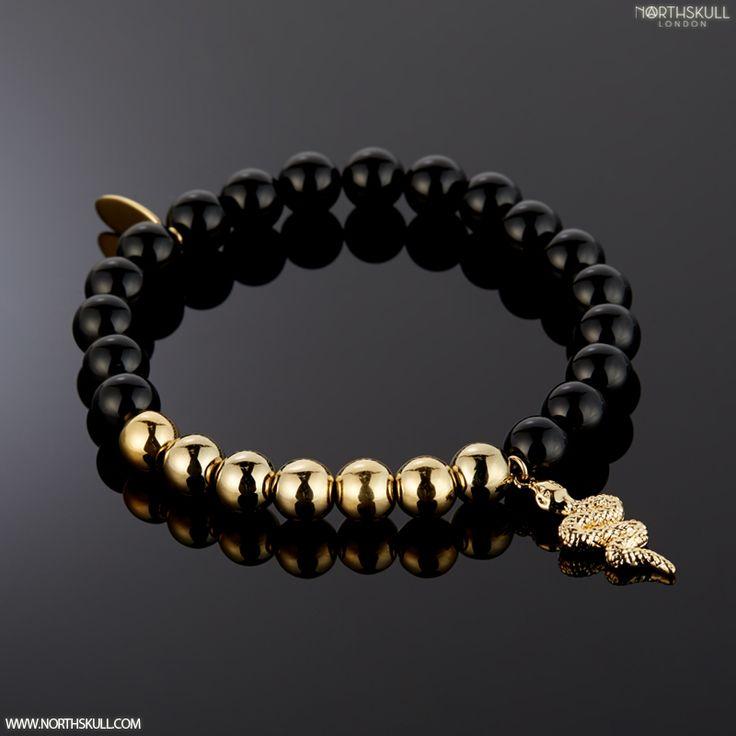 Black Onyx & 18kt. Gold Snake Charm. www.Northskull.com
