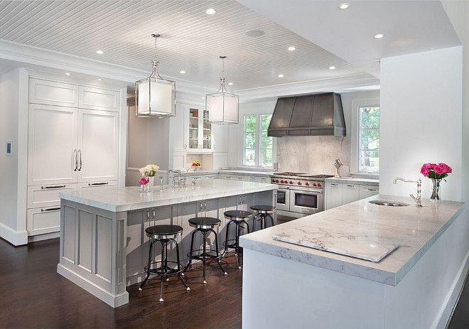 Kitchen with crisp white cabinets zinc hood gray island for Kitchen zinc design