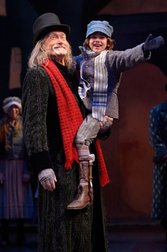 "In A.C.T.'s annual holiday favorite, ""A Christmas Carol,"" James Carpenter (L) is Ebenezer Scrooge and Carmen Steele (R) is Tiny Tim Cratchit..."