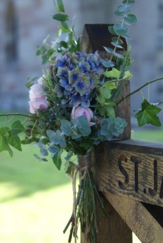 Tied posies for gate posts (not in blue). These would look pretty along the bridge using your wedding colors.