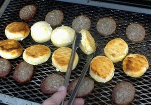 Canned biscuit on grill - 10 min. with closed lid. Same method for canned cinnamon rolls.