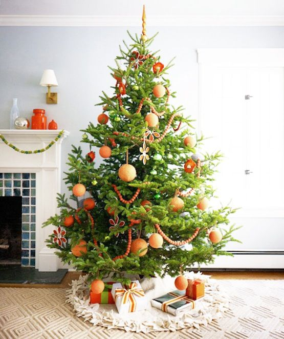 Orange color themed Christmas tree. Orange is fun and if your someone who likes to put your tree up before Thanksgiving this won't feel too out of place on turkey day!