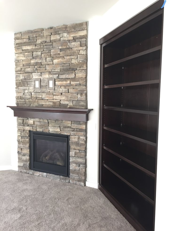 Custom Bookcases And Fireplace Details Stone By El Dorado