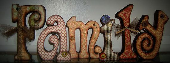 Beautiful family wooden letters decorated by WhataHootCreations