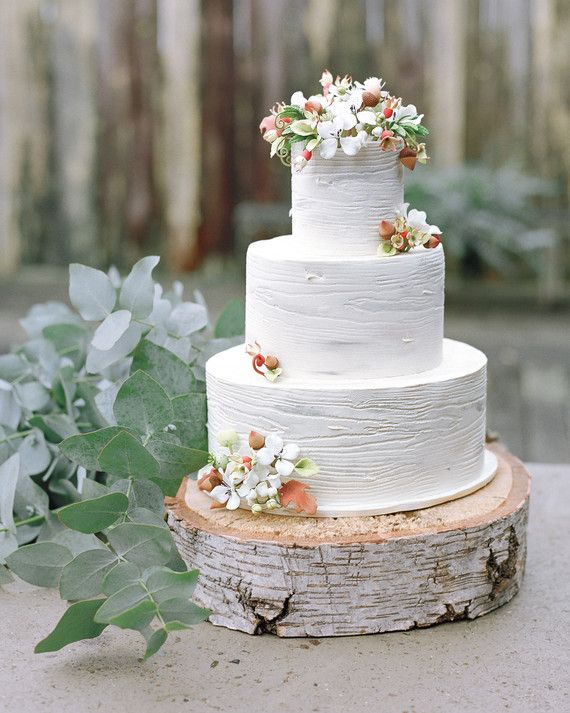 Sam Godfrey, the owner of California's Perfect Endings bakery gave the frosting of this genoise wedding cake a faux-bois finish to look like wood.