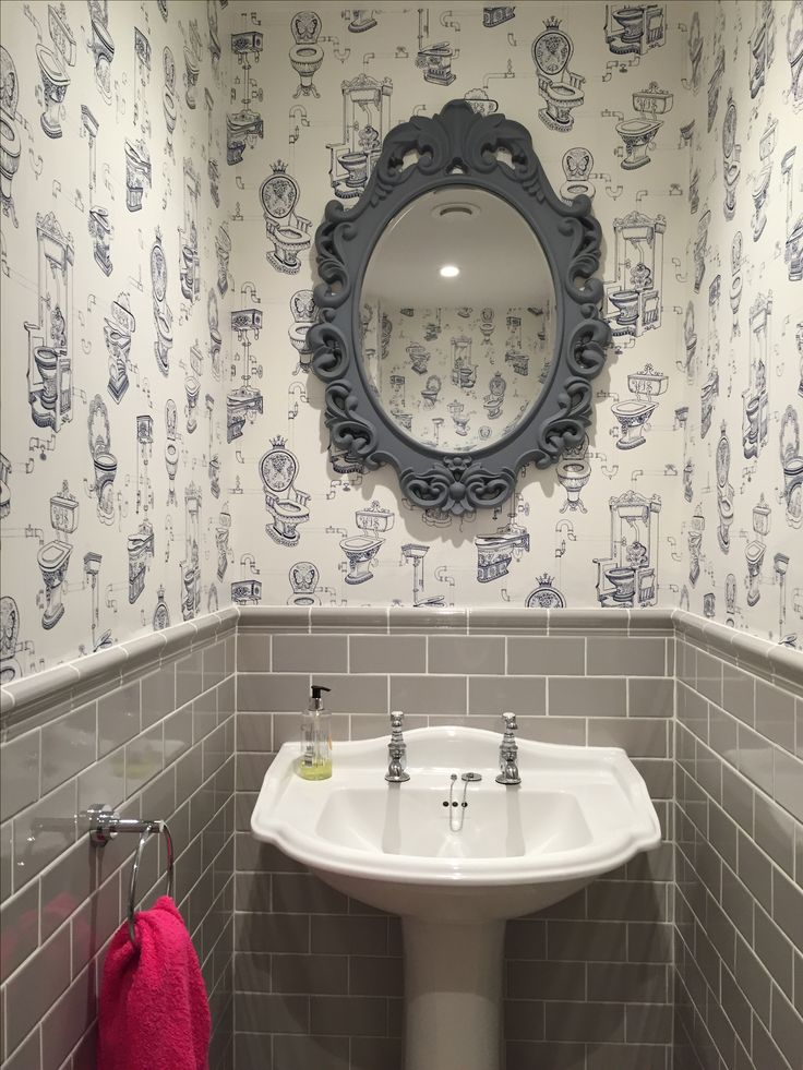 Our Downstairs toilet, fun wallpaper from Graham & Brown blue loo loo. With Fired Earth tiles.