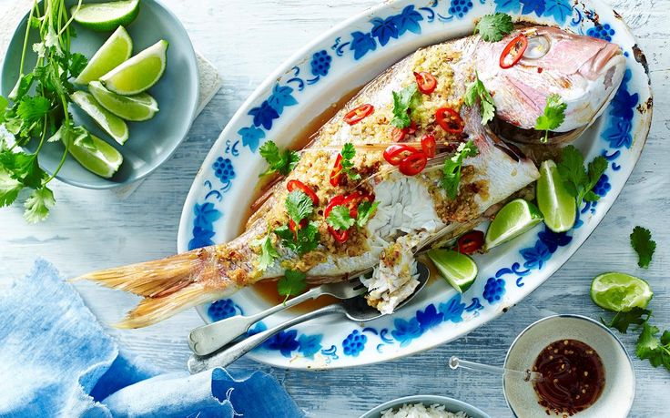 This Asian-style whole baked snapper explodes with glorious ginger and lemongrass flavours plus, it's quick and easy to bake in foil! By Australian Women's Weekly.