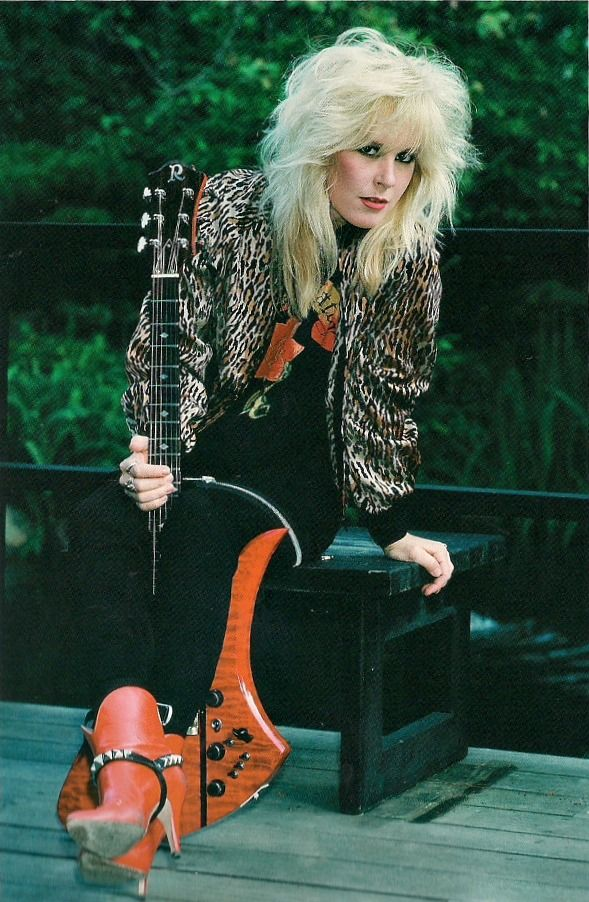 Lita Ford. From the Runaways to her 90's solo career, I was hooked. I remember seeing the kiss me deadly film clip when I was 14 and thinking, this is the coolest chick ever! She's sexy and she's an awesome guitarist.