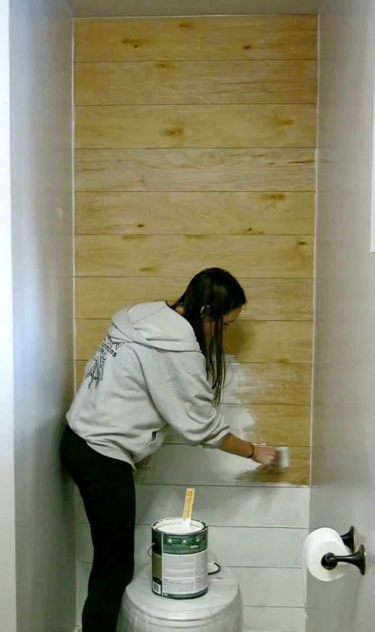 I like the idea of faux shiplap, especially behind the toilet! White shiplap in bathroom | DIY Shiplap Tutorials | Paint plywood planks white to make fake shiplap | Cheap and easy ship lap with fixer upper design style | Bring out your inner Joanna Gaines in your house | Farmhouse style bathroom | How to build shiplap wall