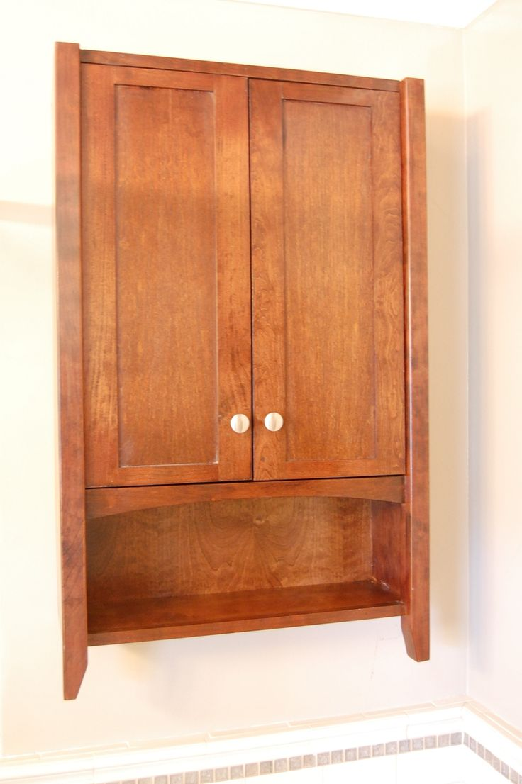 Bathroom cabinet for above toilet would like a rod on for Hanging bathroom cabinet