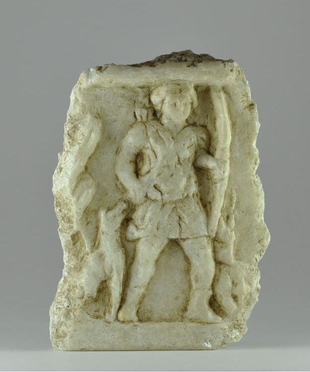 Roman marble Diana frieze, 1st-3rd century A.D. A section of carved frieze depicting the goddess Diana with bow and hunting dog, a quiver to her right shoulder, vegetation in the field, raised border above and below, 12.5 cm high. Private collection