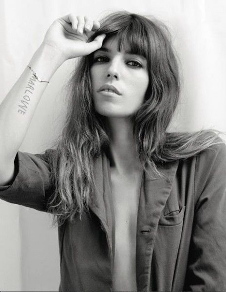 Lou Doillon. She's the daughter of Jane Birkin and director Jacques Doillon, and half sister to actress/singer Charlotte Gainsbourg.