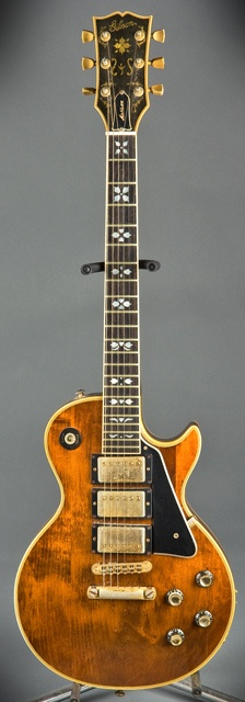 '77 Gibson Les Paul Artisan. I thought these were made of walnut at first but the finish was just called walnut.  Love the inlay too.  I am inspired to make a version that's actually made of walnut..