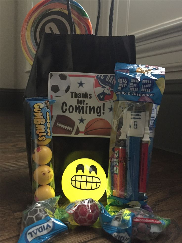 Kid's Sports Party Favor Bag - Emoji Bubble Bum (Amazon), Emoji Light Up Bouncy Ball (Amazon), Large Lollipop with an Avery Print-At-Home Label, Star Wars Pez Dispenser and Soccer Gum Balls in a Black Paper Bag (Target) with an Avery Print-At-Home Label.