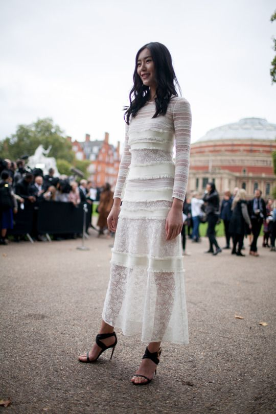 Seen outside a runway show.... London .... Boho chic with a hint of whimsy....