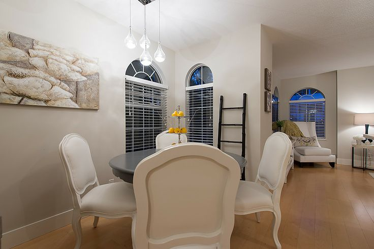 Separate area for dining with custom chandelier.