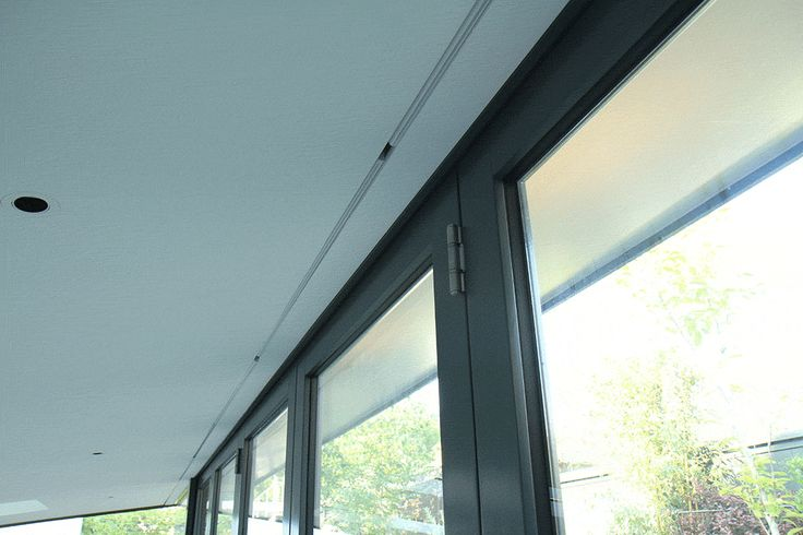 Concealed roller blinds in bi-folding doors.   #Recessed blinds #Recessed shades #Recessed roller shades