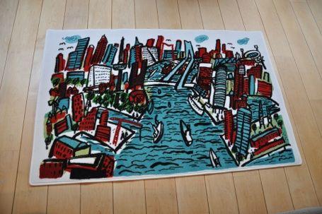 Tapijt van Stadsbeeld Rotterdam Roel Meertens Stadskunst maakt speelse en kleurrijke kunst van steden en landschappen. www.roelmeertens.nl