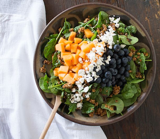 A spinach, blueberry, feta and cantaloupe salad with granola for extra crunch and a little sweetness. A great gluten-free option for croutons!