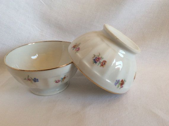 2 white and folded floral patterned breakfast bowls by LouDrap