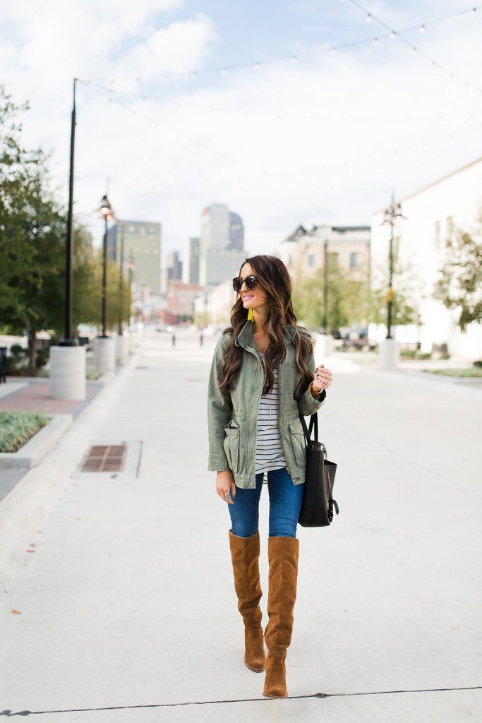 Military green jacket, black striped t-shirt, skinny jeans, carmel brown over-the-knee suede boots, black handbag, long gold pendant necklace