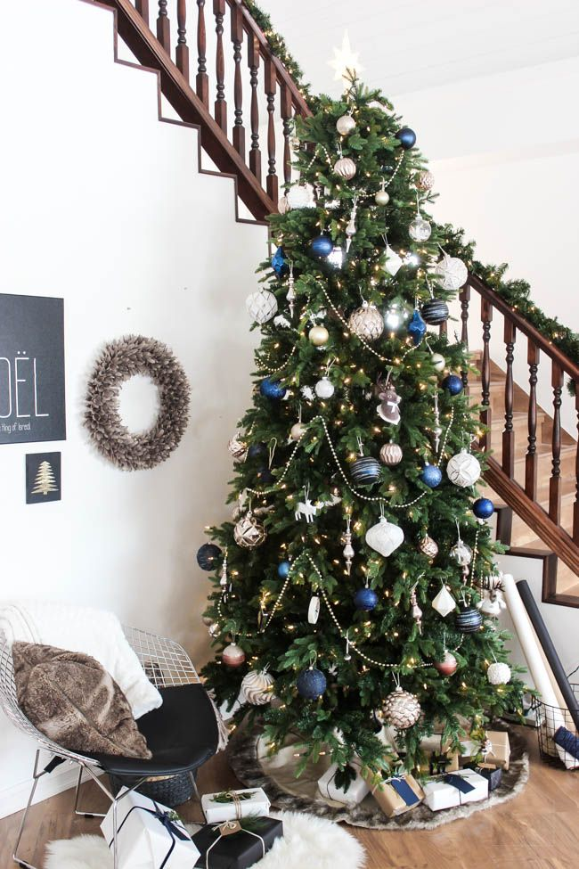 A Beautiful Wintery Tree For The Christmas Season Love The Blue White And Gold Combination Bead Garland Christmas Tree Christmas Tree Design Christmas Tree
