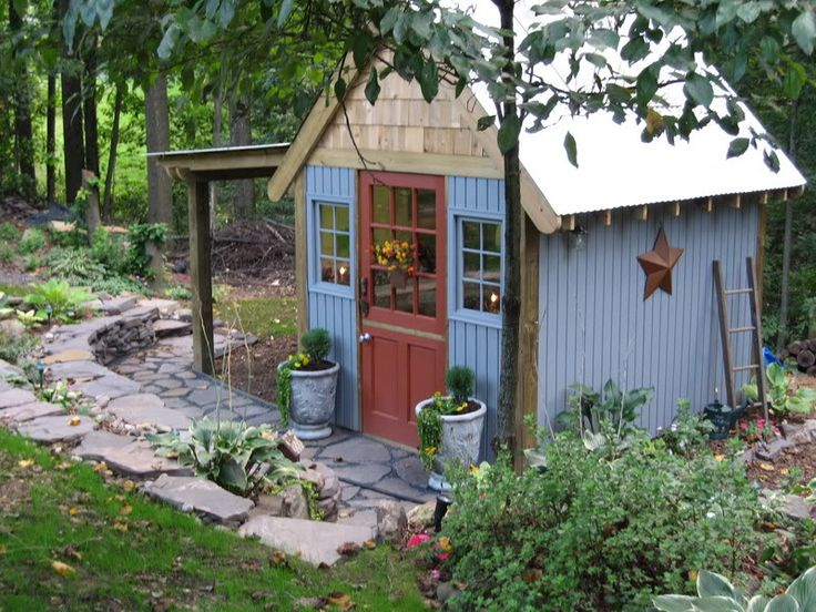Cute little blue potting shed!  http://forums.gardenweb.com/forums/load/hosta/msg0921522610419.html