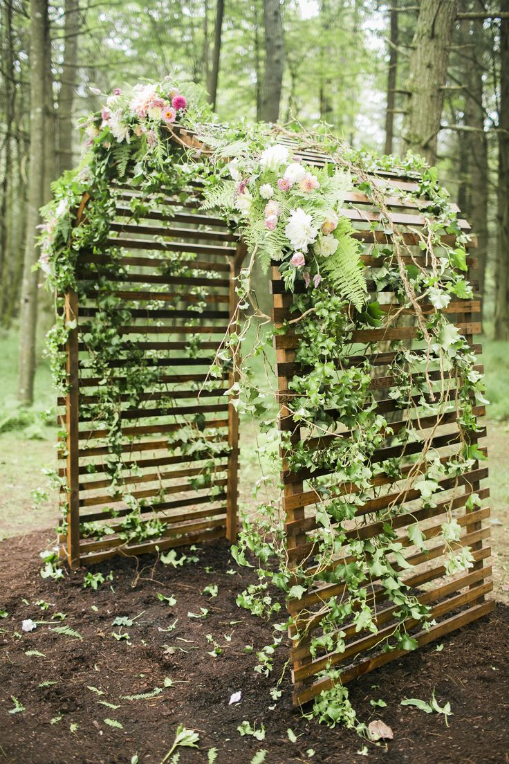 Fairytale outdoor wedding ceremony, curved arbor made of wood, romantic pink flowers and greenery // Sidney Leigh Photography