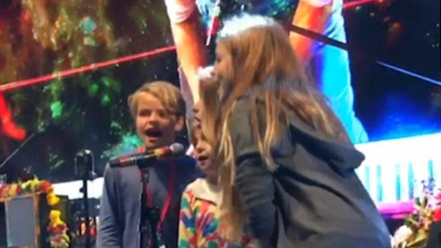 Gwyneth Paltrow and Chris Martin's children perform on stage with Coldplay at Glastonbury