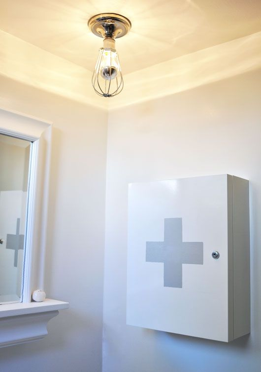 Via SF Girl by Bay | DIY Swiss Cross Medicine Cabinet |