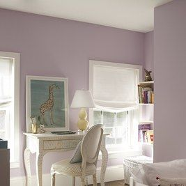 """""""Designing rooms for children is fun because we get to be playful with color,"""" says Walish. The soft purple on the walls is only enhanced by the sunlight that the space receives throughout the day. The designers found the Moroccan rug on a buying trip."""