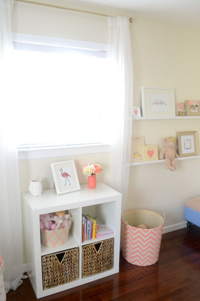 I like the little white shelves on the wall next to to the window. Maybe do this in the nursery with IKEA or DIY shelves. {via Project Nursery}
