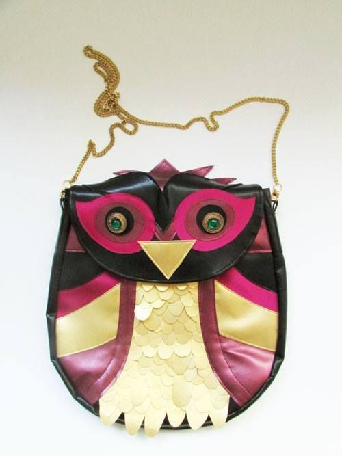 """Royal Owl""  Handmade Leather Bag with gold lace and green smarald buttons for eyes. A collage from different colours of leather trasformed into a Owl. #leather #collageleather #handmade #gold #royal #colours #owl #leatherowl"