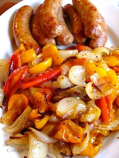 A perfect easy sheet pan meal, Roasted Sausages with Peppers and Onions uses fresh seasonal produce teamed with sausage for a one dish dinner.