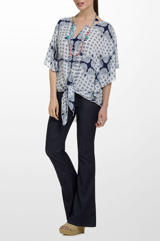 Sarah Lawrence - bat sleeve printed tunic, flare denim pant, beaded necklace with tassels.