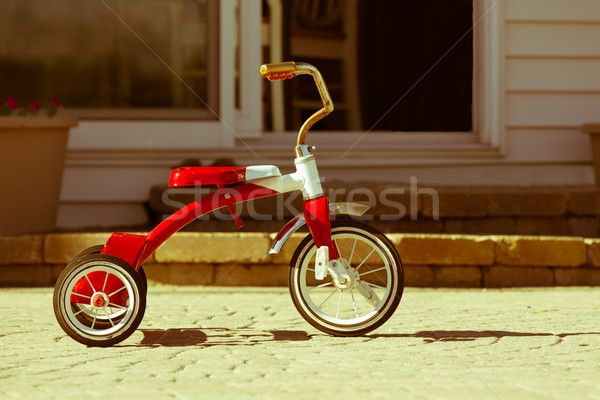 Child's rusted red tricycle standing ready stock photo (c) ozgur (#5486508) | Stockfresh