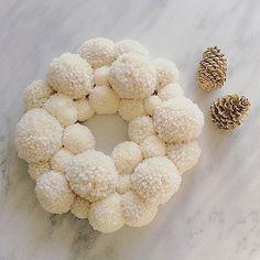 White pom pom wreath