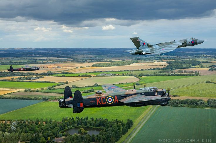 The Avro 'Three Sisters' formate over the Lincolnshire countryside to honour all those who served in Bomber Command. Picture taken from the chase Hawk aircraft by John M. Dibbs.