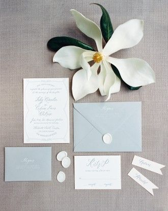 Jessica Rourke, wedding planner and owner of Lady Letterpress, designed the blue and gray invitation suite which included calligraphy by Lydia Robins Hendrix and wax seals.