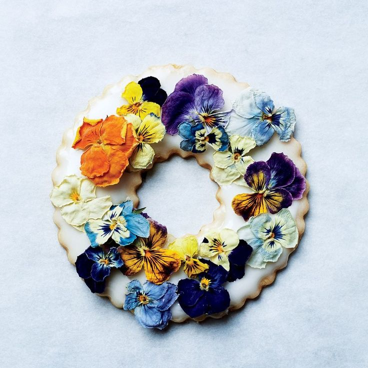 Candied herbs, edible dried flowers, and freeze-dried berries are beautiful decorations for these iced cookie wreaths. Learn how to make the shortbread <a href=