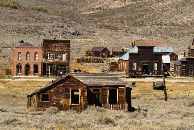 """Route 66   Oatman, Arizona considers itself a """"living"""" ghost town, complete with gift shops, staged gunfights and wild burros wandering through town."""