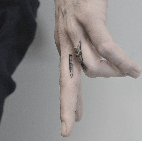 Tiny knife tattoo by Kane Navasard