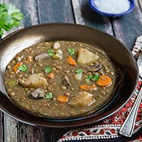 Big chunks of potato and carrots along with mushrooms make this vegan lentil soup almost as hearty as a stew.