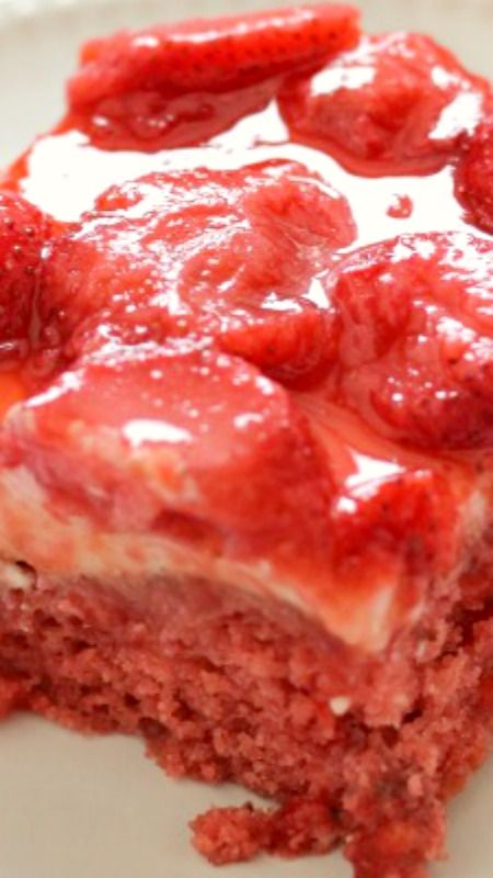 Strawberry Wet Cake ~ A super moist strawberry cake filled with real strawberries and strawberry jello and topped with a wonderful cream cheese icing and more strawberries...  It's perfect for a crowd!