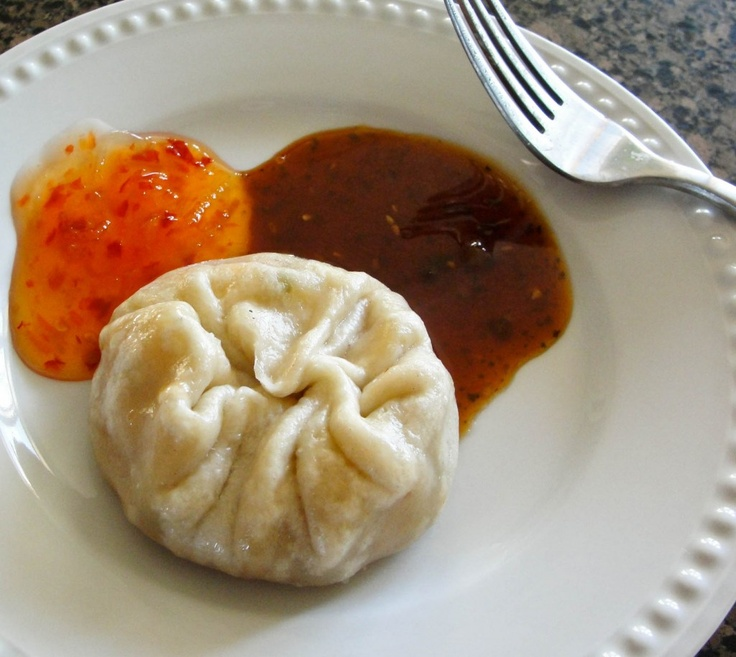 Tibetan Momos.  A momo is basically a dumpling made with a flour/water based dough.  They are native to Nepal and Tibet, and are very popular in the North-Eastern part of India.  Inside the dough is a mixture of veggies, meats (optional) and aromatics. They can be steamed, fried and even boiled in soups.